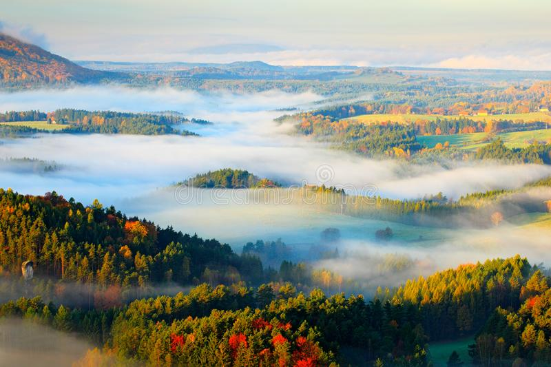 Czech typical autumn landscape. Hills and villages with foggy morning. Morning fall valley of Bohemian Switzerland park. Hills wit. H fog royalty free stock photography
