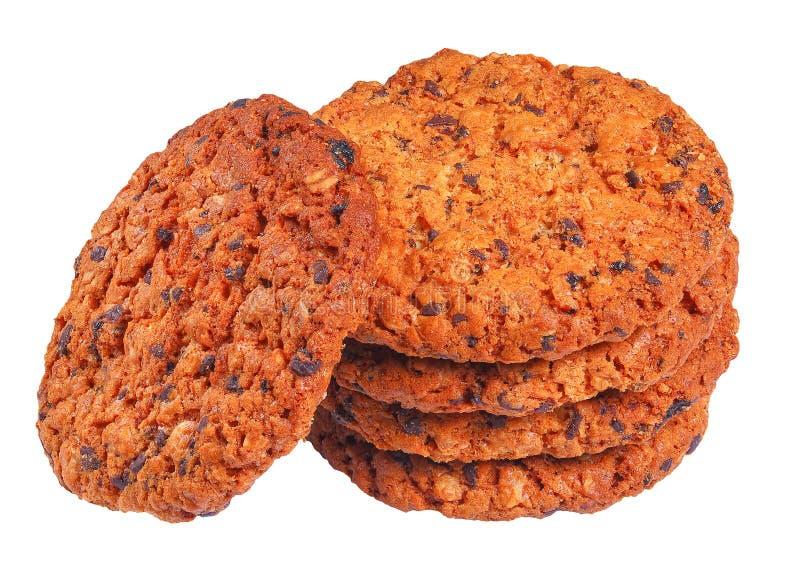 Czekoladowego układu scalonego oatmeal ciastka odizolowywający na bielu obraz royalty free
