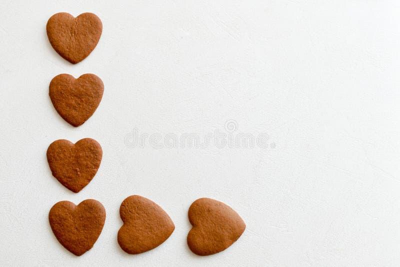 Czekoladowi serca na białych tło sercach miłość dla góruje obrazy royalty free