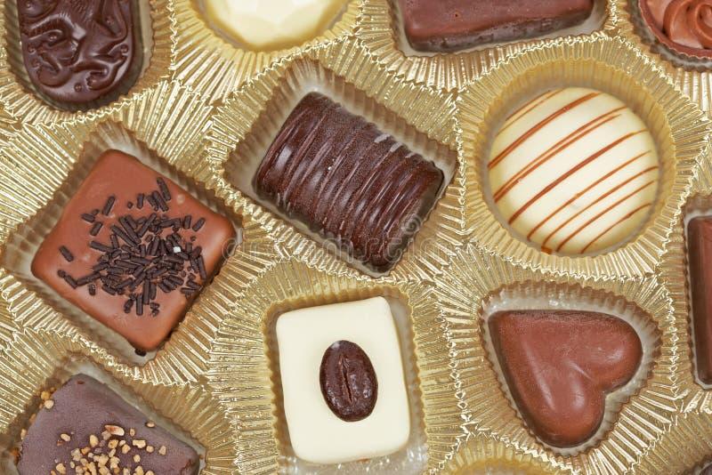 czekoladowi tło cukierki obrazy stock