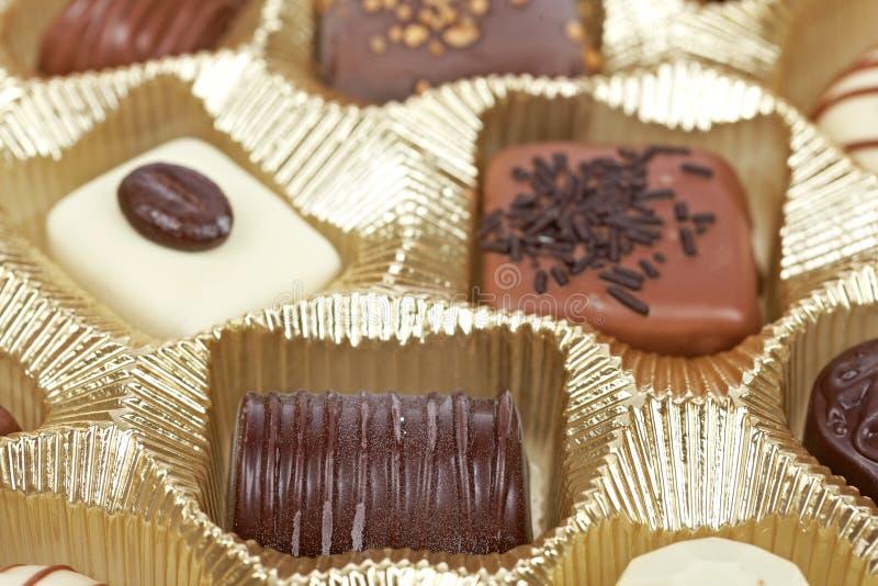 czekoladowi tło cukierki obraz stock