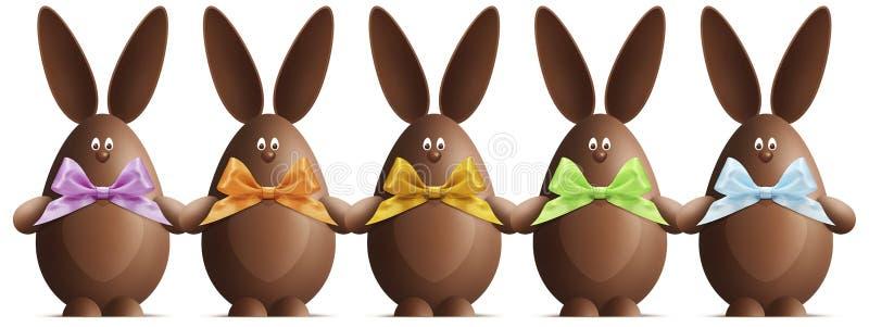 Czekoladowi Wielkanocni króliki z faborkami one kłaniają się w różnorodnych kolorach dalej royalty ilustracja