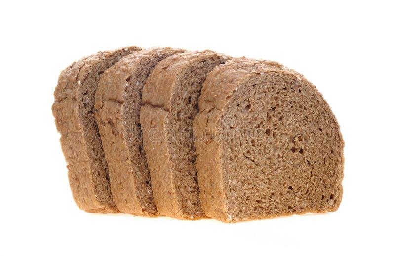 Czekoladowy chleb pokrajać kłaść na białym tle obraz stock