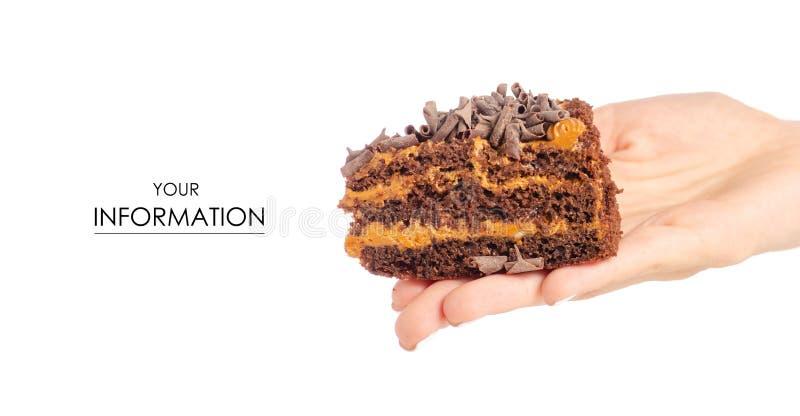 Czekoladowy kawałek tort w ręka wzorze obraz royalty free