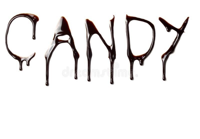 czekoladowych karmowych wycieku listów ciekły słodki syrop zdjęcie royalty free
