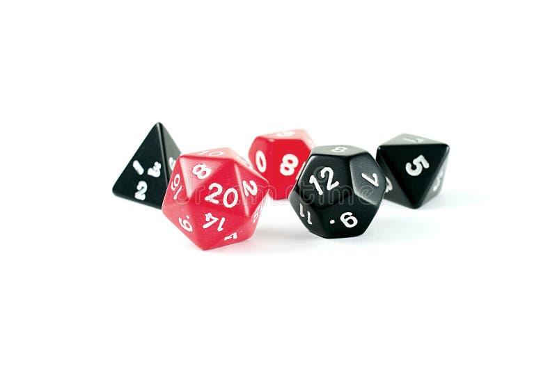 czernić kostka do gry wielo- fotografii czerwień popierającą kogoś zdjęcia stock