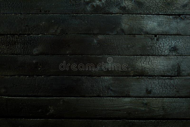 Czernić przypalał drewnianą panelu tła teksturę zdjęcia stock