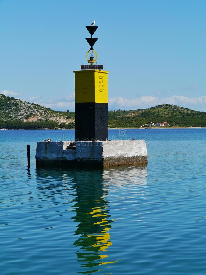 Czerni i yelllow bakan w Adriatyckim morzu obrazy royalty free