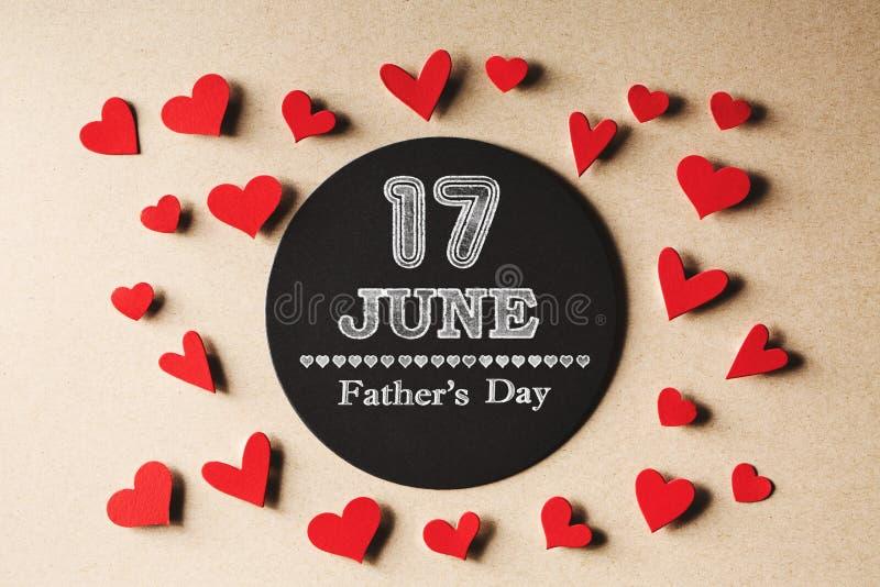 17 Czerwa ojców dnia wiadomość z małymi sercami obrazy stock