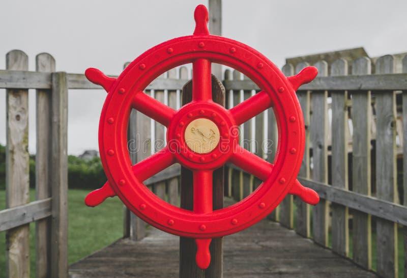 Czerwona boisko statku kierownica obraz stock
