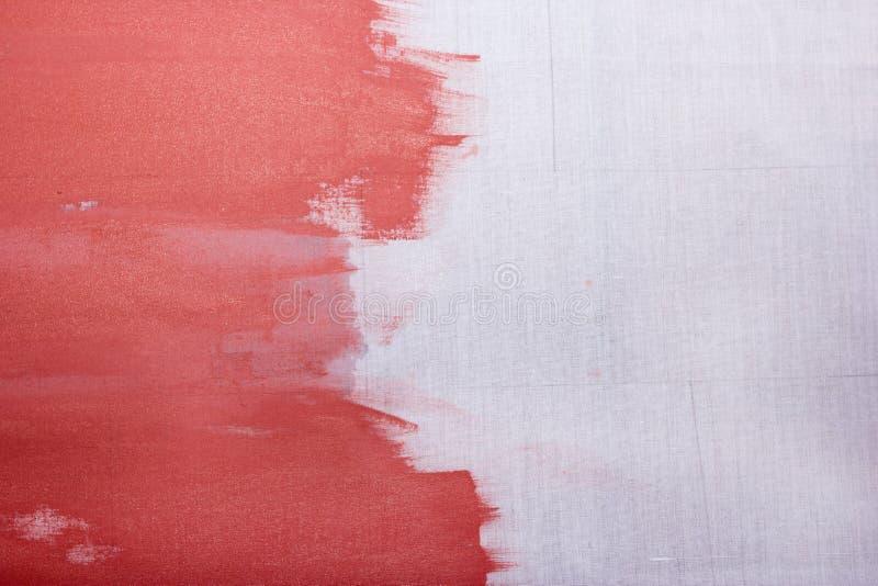 Czerwona farba na szarym płótnie, abstrakcjonistyczny tło zdjęcie royalty free