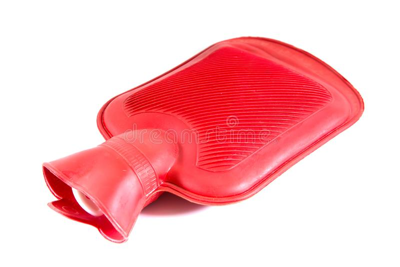 Czerwona krzem gorącej wody butelka na białym tle, gorącej wody torba fotografia stock