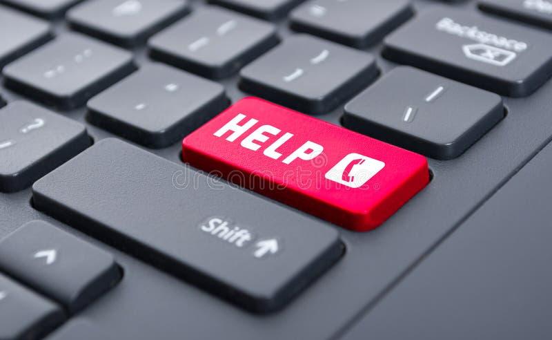 Czerwona pomoc z wywoławczym symbolu guzikiem na klawiaturowym pojęciu obraz stock