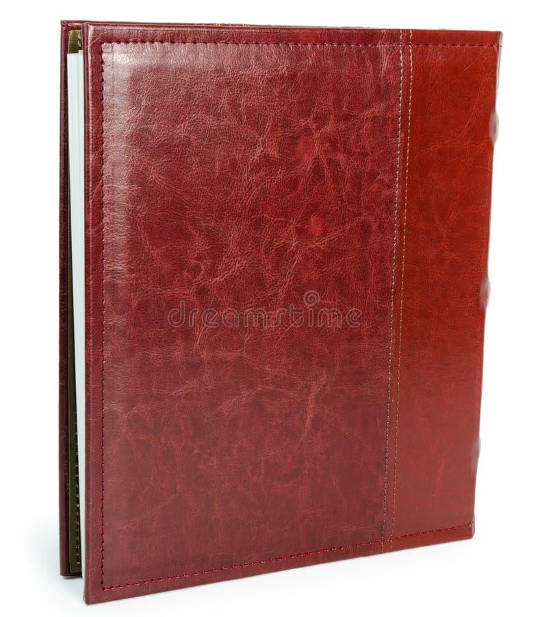 Czerwona skóry książka na wite backround zdjęcia stock