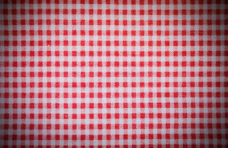 czerwona w kratkę ręcznikowa tekstura z winietą tło, kuchnia obrazy stock