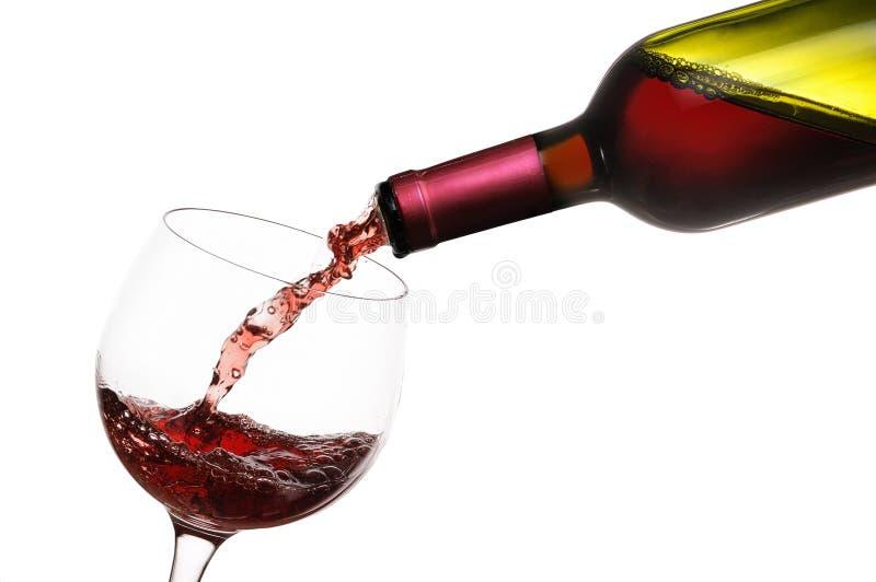 czerwone wino dolewania zdjęcie royalty free