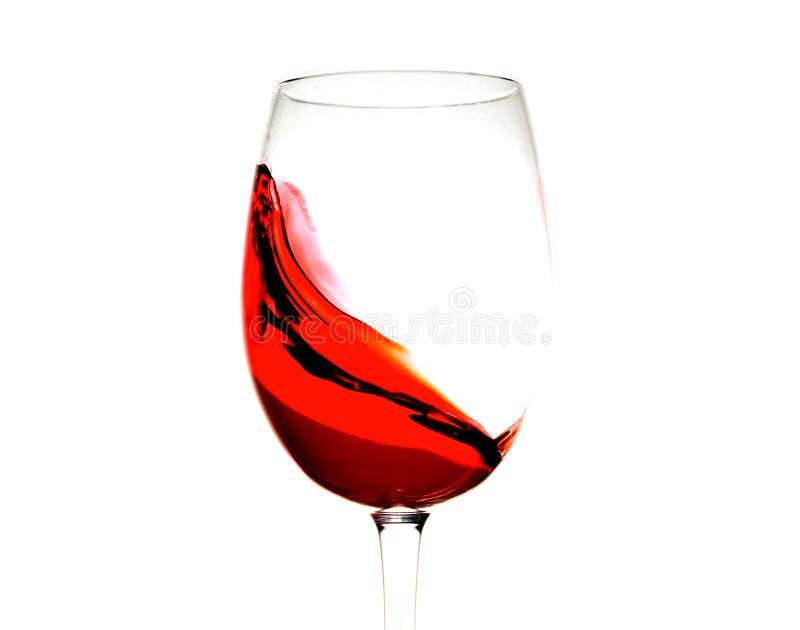 Czerwone wino w szkle odizolowywającym, bryzgający, pluśnięcie, fala up odizolowywająca czerwonego wina zakończenie fotografia royalty free
