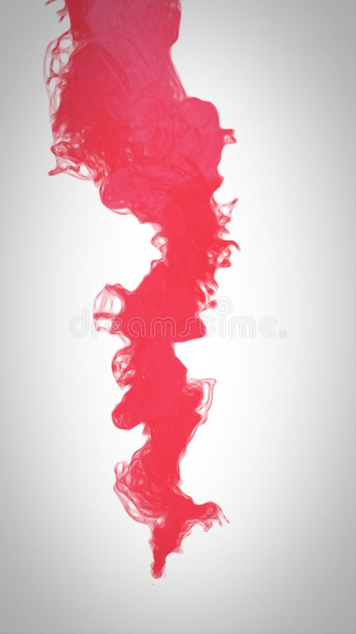 Czerwonego koloru farby dolewanie w wodzie zdjęcia stock