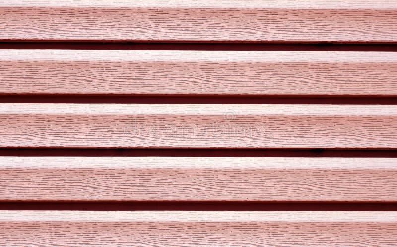 Czerwonego koloru panelu ściany plastikowy wzór zdjęcia stock