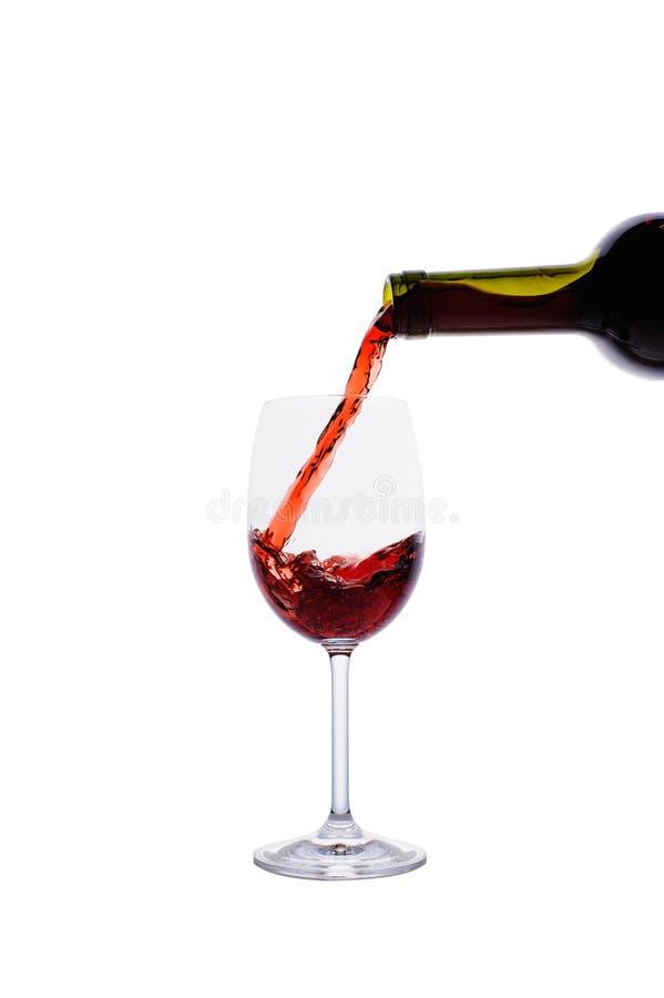 Czerwonego Wina Dolewanie W Wina Szkło Bezpłatny Obraz Stock