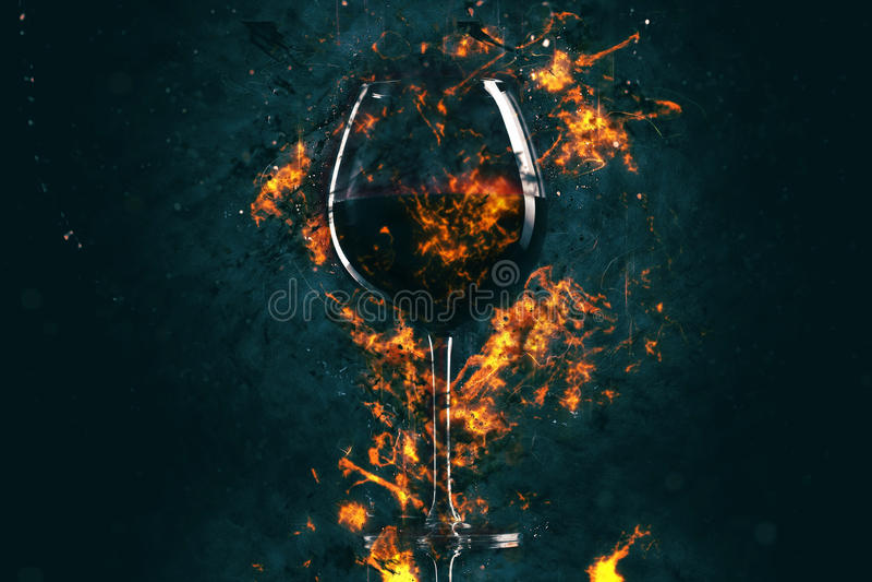 Czerwonego wina szkło w ogieniu obrazy stock