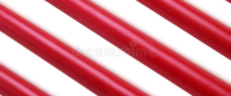 Czerwonej Białej wosk świeczki kija przekątny tła Pasiasta tekstura zdjęcia royalty free