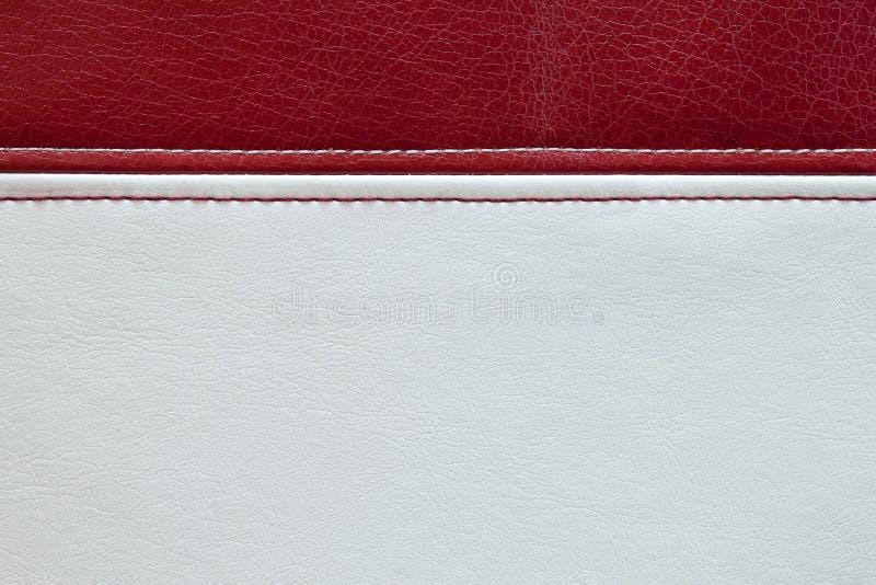 Czerwonej i białej skóry tekstury tło zdjęcie stock