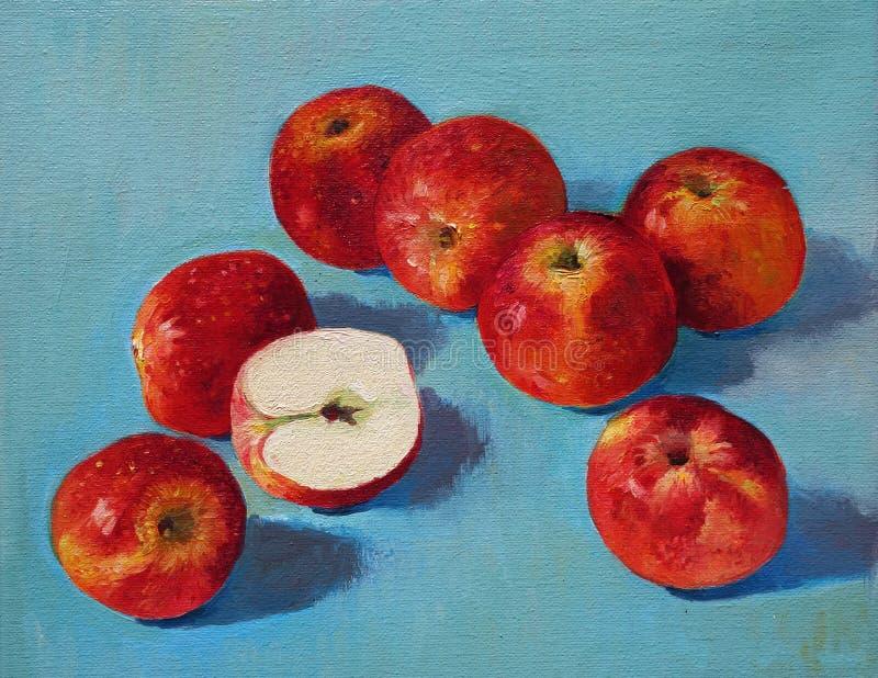 Czerwoni jabłka na błękitnym tle obrazy royalty free