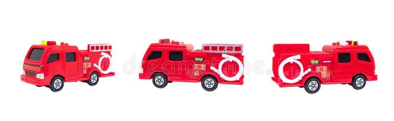 Czerwoni samochody strażaccy odizolowywający na białym tle obraz royalty free