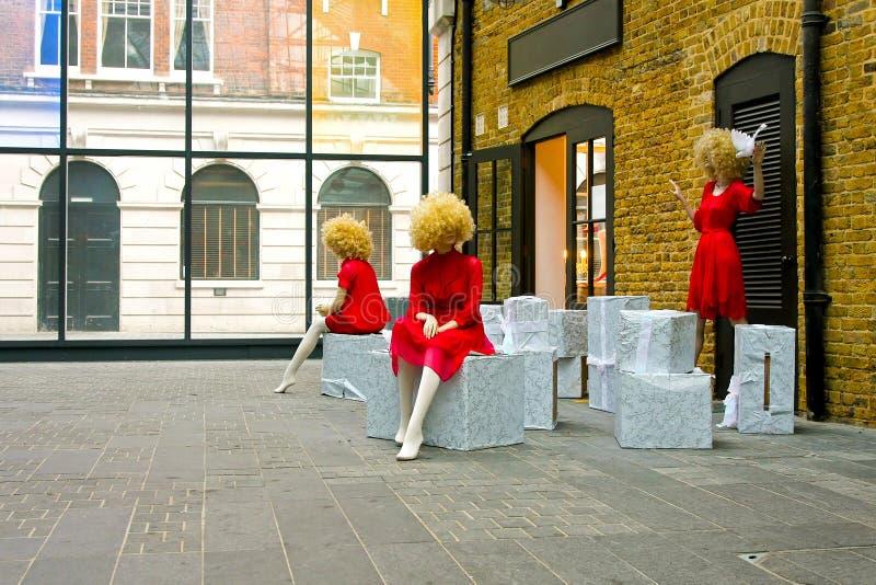 czerwoni smokingowi mannequins obraz royalty free