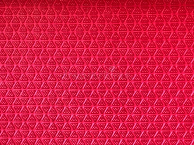 Czerwoni trójboki kształtują bezszwowego, abstrakt na czerwieni obraz stock