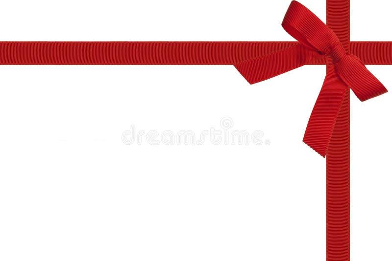 Czerwony łęk i faborek na bielu obrazy royalty free