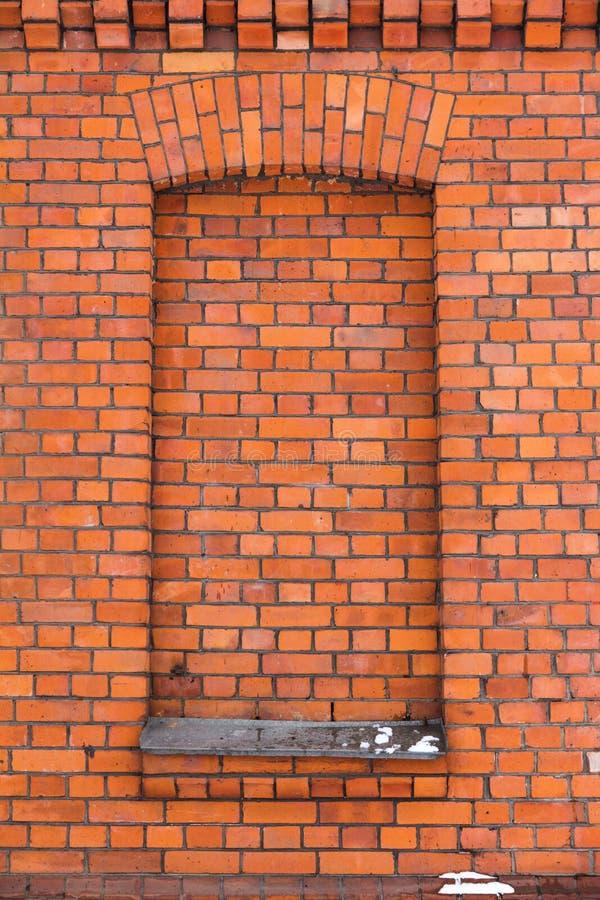 Czerwony ściana z cegieł i okno fotografia stock