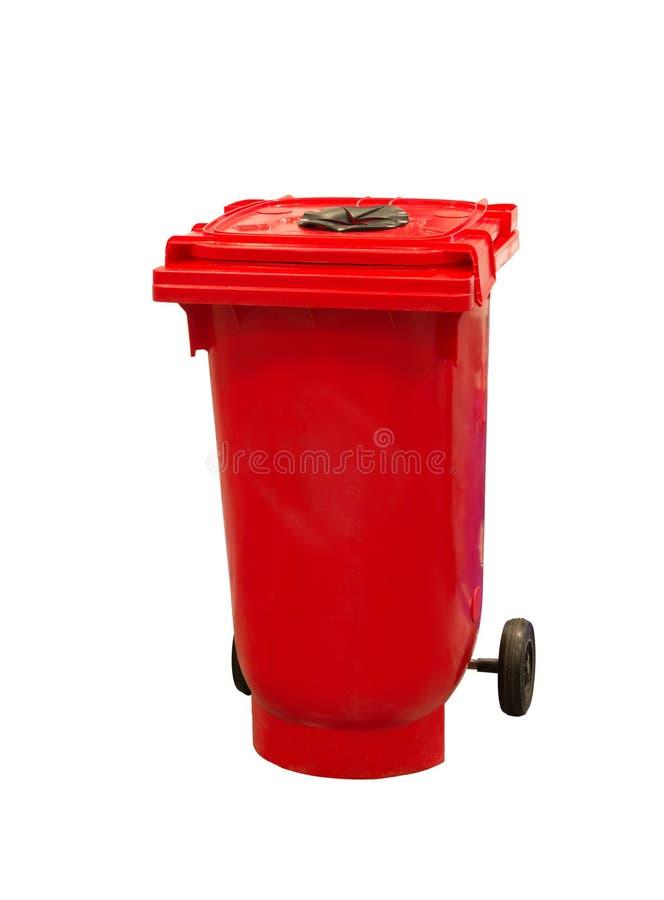 Czerwony śmieciarski kosz na śmieci odizolowywający na bielu obraz royalty free