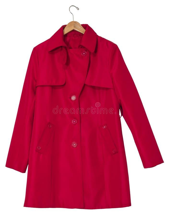 Czerwony deszczowiec na wieszaku zdjęcie stock