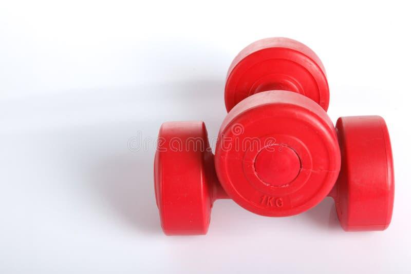 Czerwony dumbbells ciężar zdjęcia royalty free