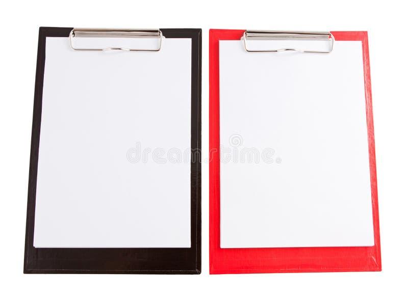 Czerwony i czarny plastikowy schowek z pustego papieru prześcieradłem zdjęcia royalty free