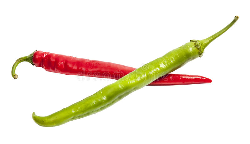 Czerwony i zielony pieprz w formie krzyż obraz stock