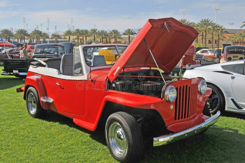 Czerwony Kaiser Jeepster desantowiec SUV obrazy royalty free