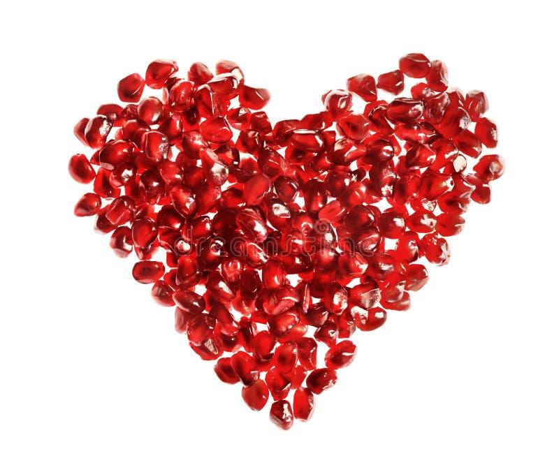 Czerwony kierowy kształt robić granatowów ziarna obrazy royalty free