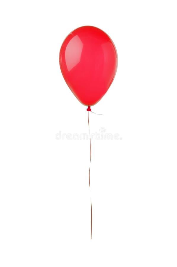 Czerwony latanie balon odizolowywający na bielu zdjęcie royalty free