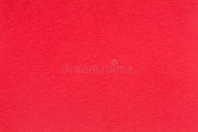 Czerwony papierowy tło z żyłkowaną teksturą fotografia stock