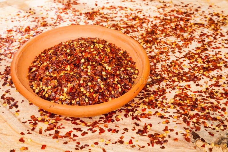 Czerwony pieprz lub Cayenne pieprz miażdżący obraz royalty free