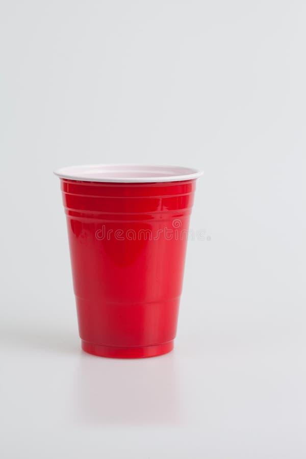 Czerwony plastikowy szkło zdjęcia royalty free