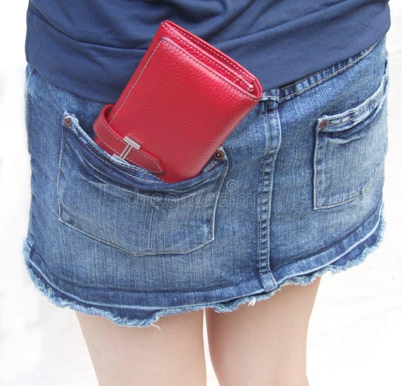 Czerwony portfel w kieszeni fotografia royalty free