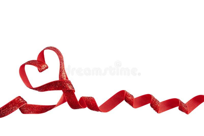 Czerwony prezenta faborek w kształcie odizolowywającym nad białym tłem serce fotografia stock
