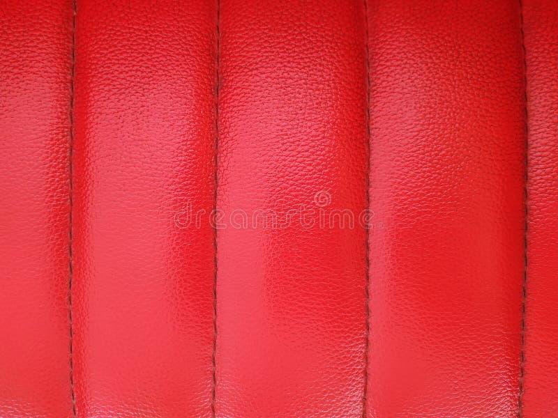 Czerwony rzemienny tekstury tła tapicerowanie zamknięty w górę obraz royalty free