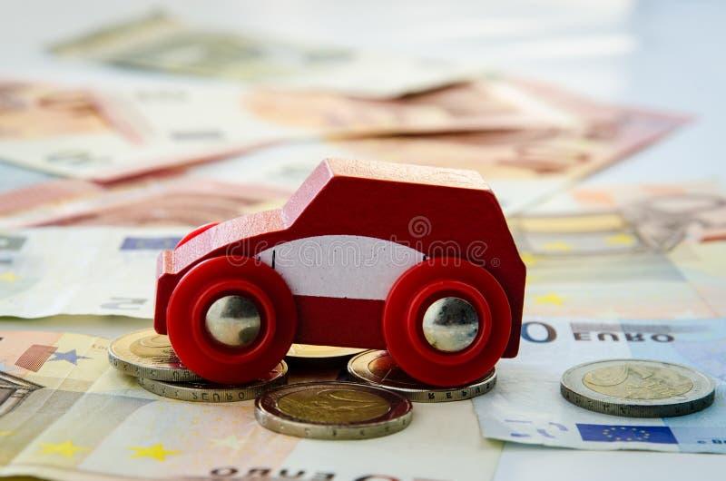 Download Czerwony Samochód I Pieniądze Zdjęcie Stock - Obraz złożonej z cara, gotówka: 57652358