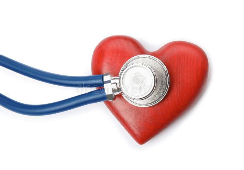 Czerwony serce i stetoskop na białym tle pojęcia kardiologii wykresu eartbeat serca człowiek zdjęcie royalty free