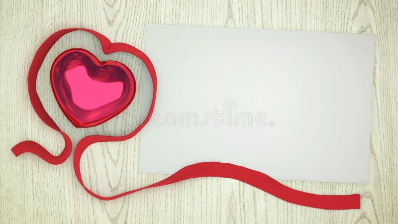 Czerwony serce z czerwonym faborkiem i kawałkiem papieru obrazy royalty free